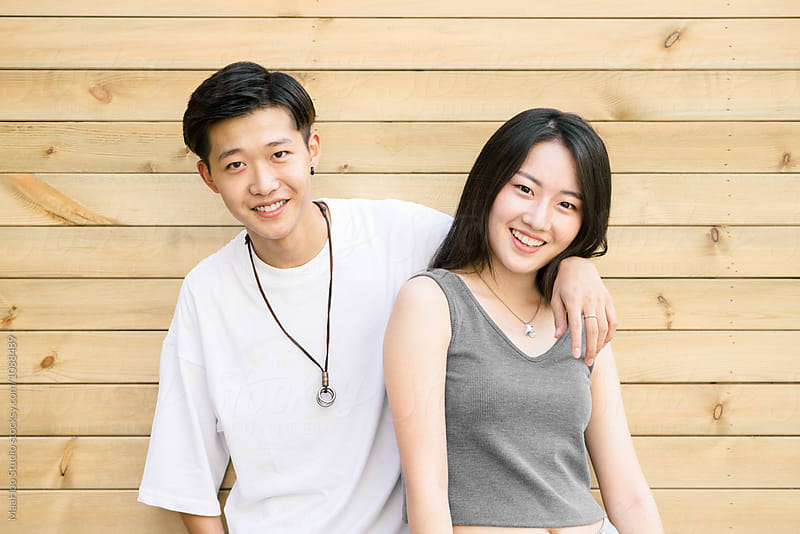 Portrait of two young Chinese teenager by MaaHoo Studio for Stocksy United