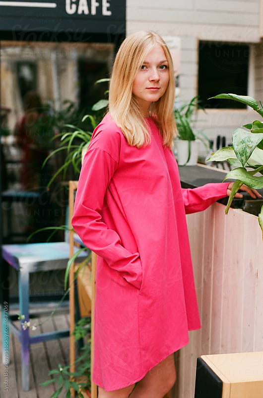 Blonde woman wearing bright pink dress by Lyuba Burakova for Stocksy United