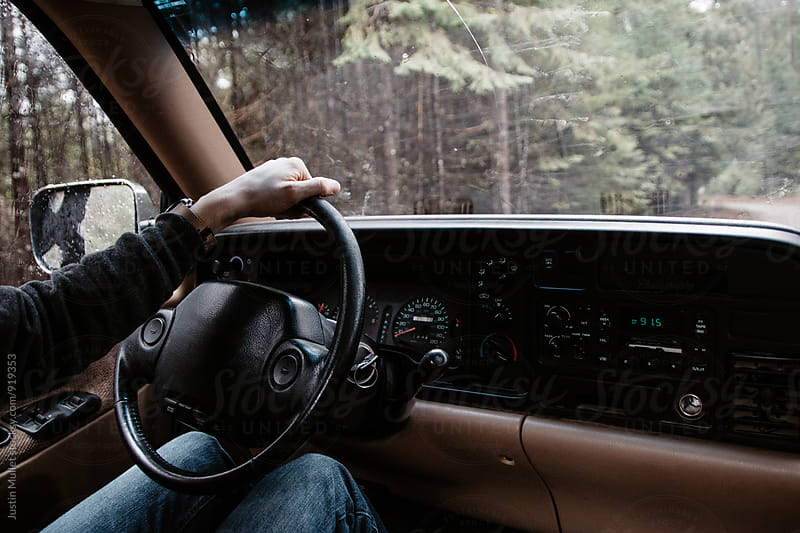 Man driving a truck, exploring. by Justin Mullet for Stocksy United