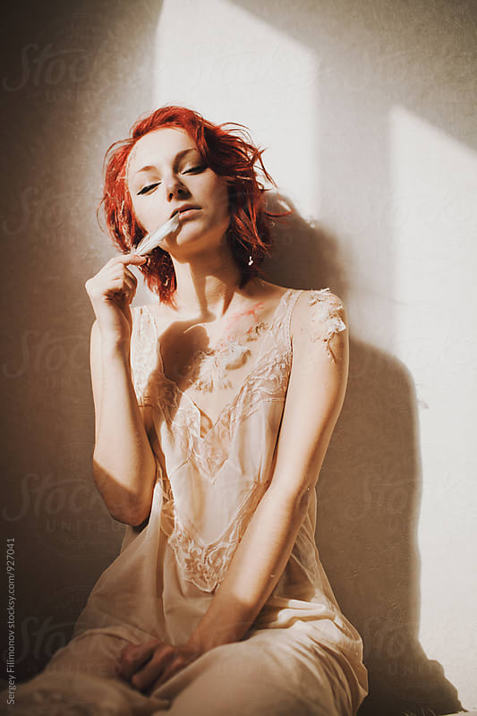 redhead young girl posing with make-up of feathers by Sergey Filimonov for Stocksy United