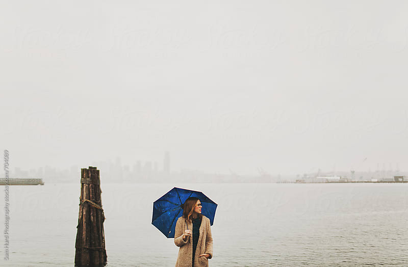 girl in fog with blue umbrella by Sam Hurd Photography for Stocksy United