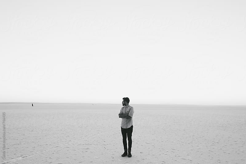 Young Man in a Salt Lake by Caleb Thal for Stocksy United