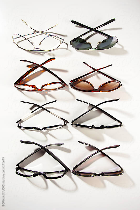 Set of glasses and sunglasses over white background. by BONNINSTUDIO for Stocksy United