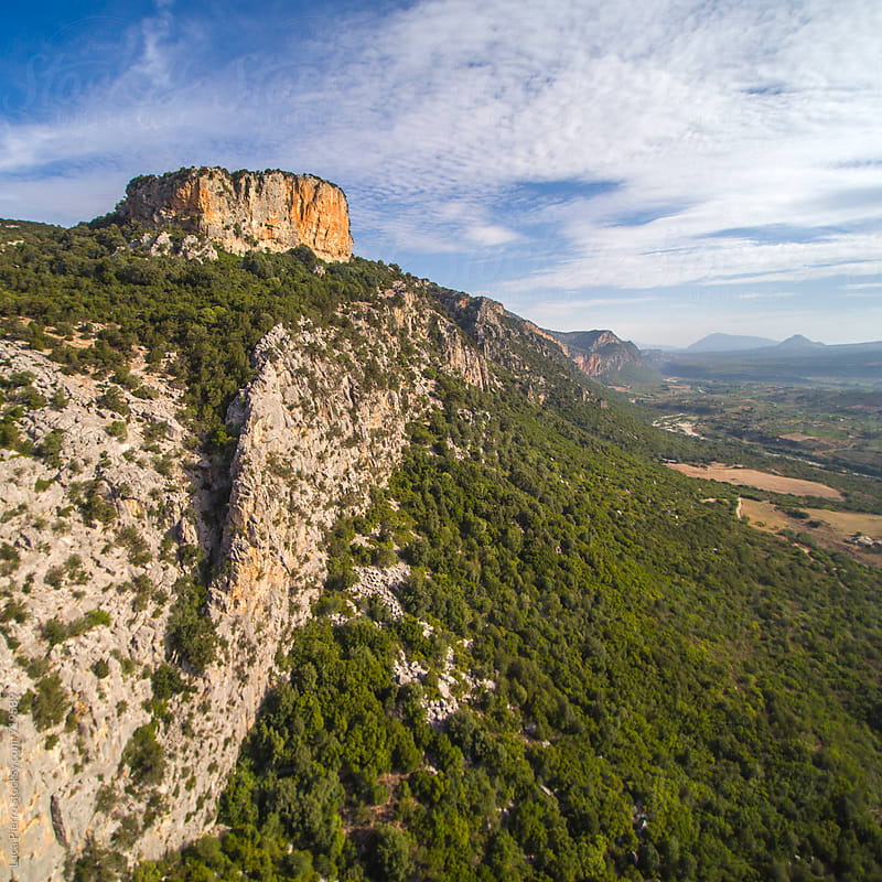 Aerial view of a mountain, Sardinia by Luca Pierro for Stocksy United