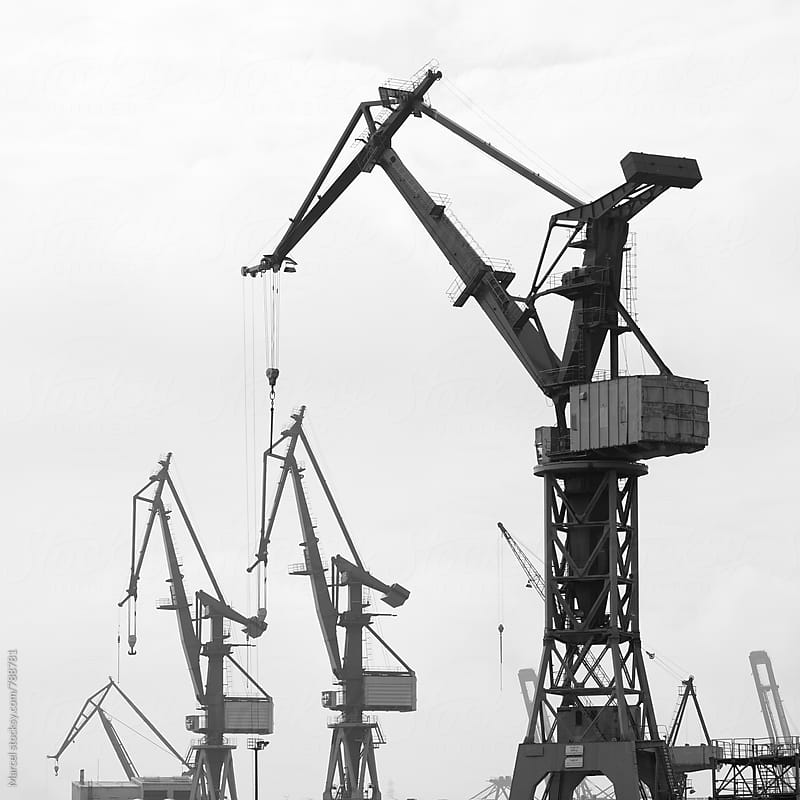 Tall cranes for unloading ships in Hamburg harbour by Marcel for Stocksy United
