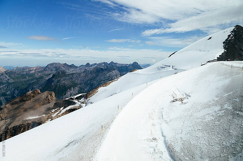 Titlis Peak in the Swiss Alps by VICTOR TORRES for Stocksy United