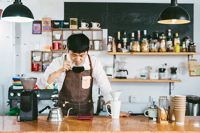 Young coffee shop owner tasting just made coffee by MaaHoo Studio for Stocksy United
