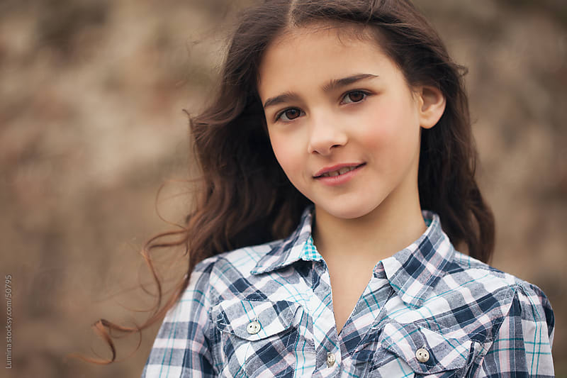 Smiling Girl Outdoors by Lumina for Stocksy United