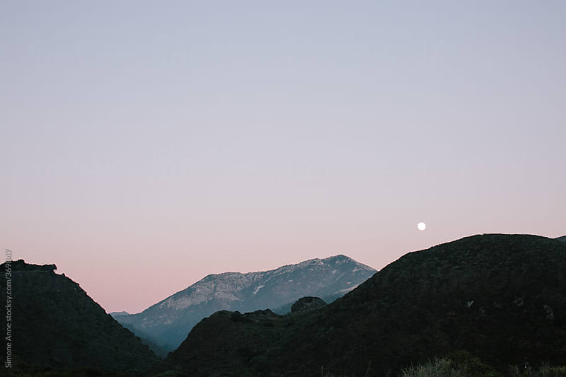 Moonrise over purple mountains by Simone Anne for Stocksy United