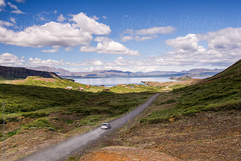 Road leading through Icelandic summer landscape by Andreas Wonisch for Stocksy United