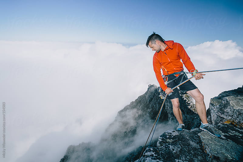 Male Mountaineer abseiling off  Table Mountain by Micky Wiswedel for Stocksy United