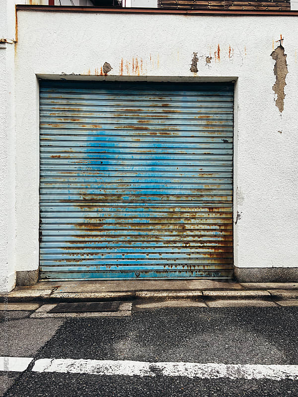 Closed Blue Garage Roller Shutter by Julien L. Balmer for Stocksy United