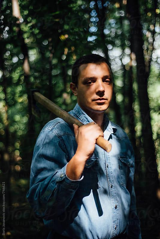 Portrait of lumberjack  by Boris Jovanovic for Stocksy United