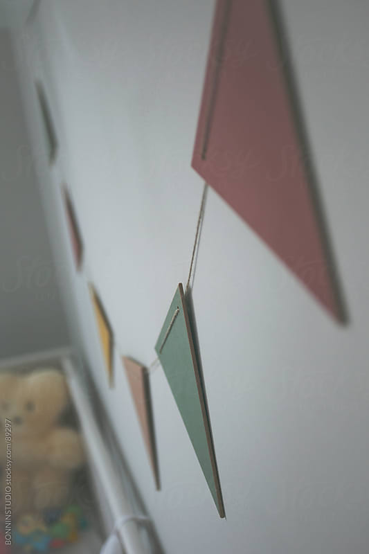 A cute baby room with colorful garland. Pastel tones. by BONNINSTUDIO for Stocksy United