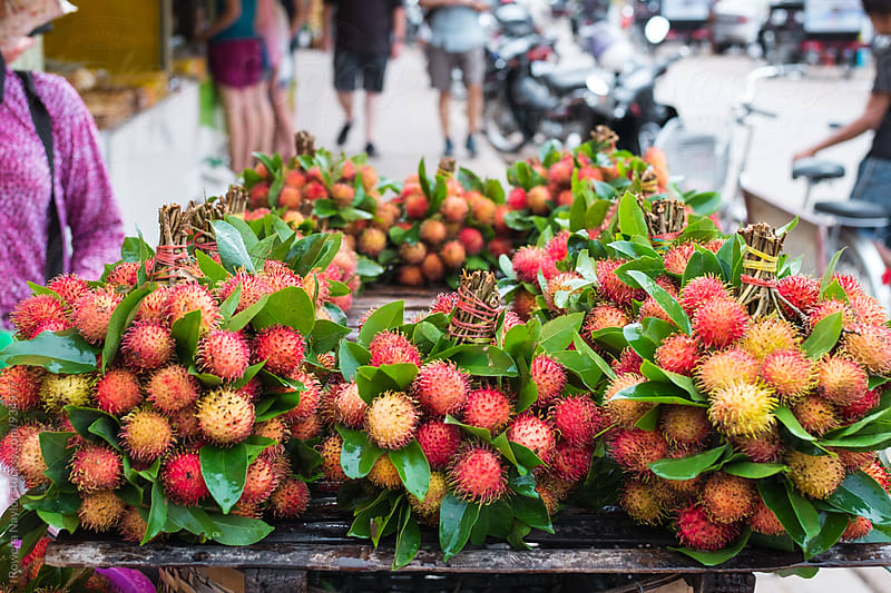 Fresh Lychees at a food market by Rowena Naylor for Stocksy United