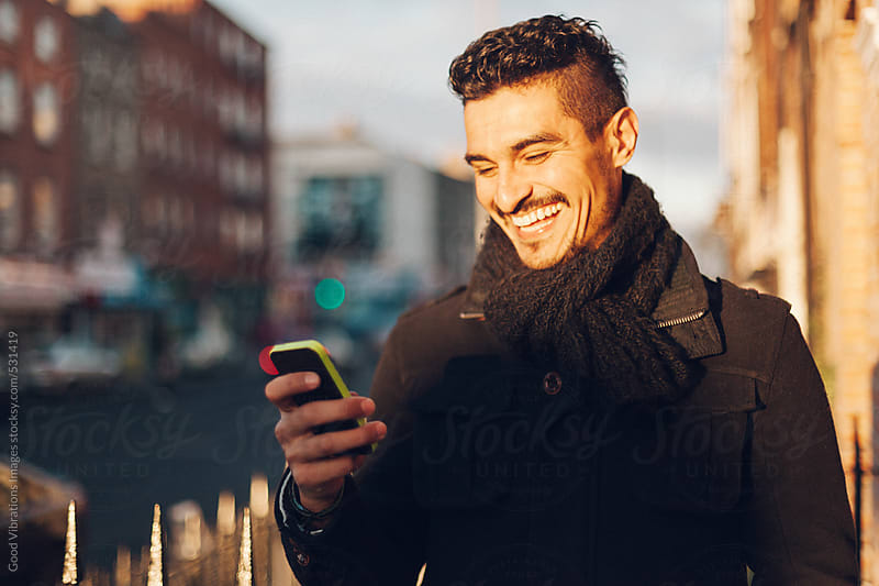 Cool Man checking the cell phone by Good Vibrations Images for Stocksy United