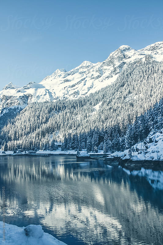 snowcovered landscape on a small lake by Leander Nardin for Stocksy United