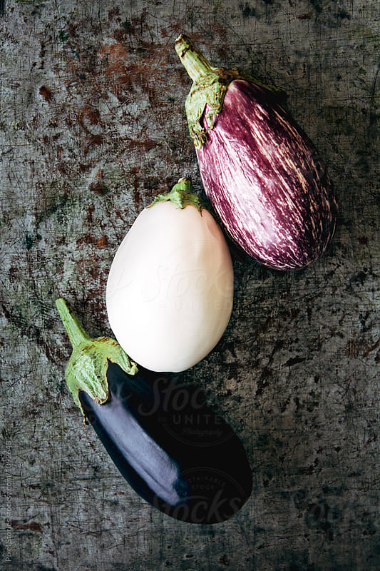 Three types of eggplants on metal background by Pixel Stories for Stocksy United