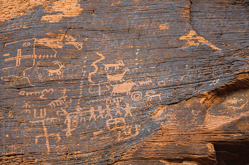 Prehistoric petroglyph drawings by Amy Covington for Stocksy United