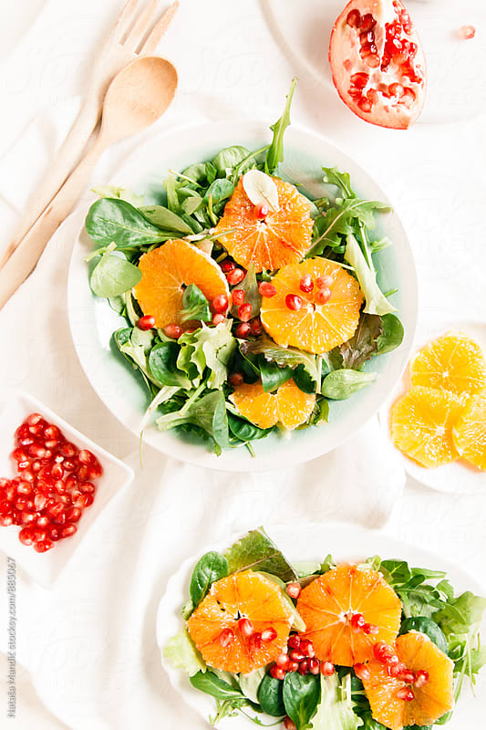 Salad with orange and pomegranate by Nataša Mandić for Stocksy United