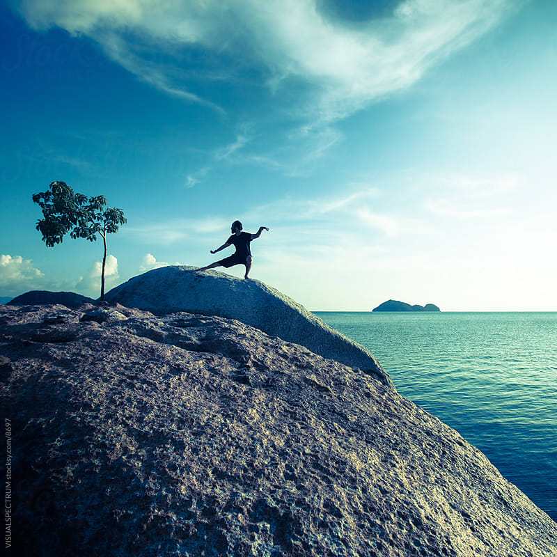Man Performing Tai Chi By The Ocean by VISUALSPECTRUM for Stocksy United