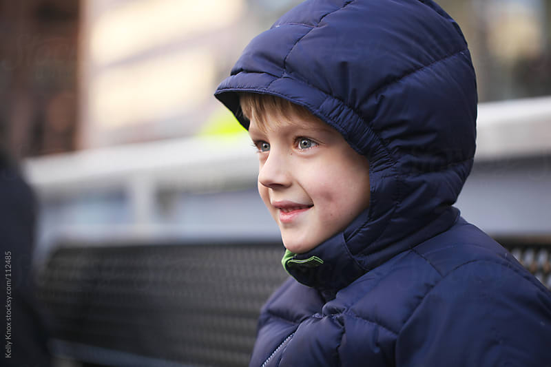winter portrait of a boy by Kelly Knox for Stocksy United