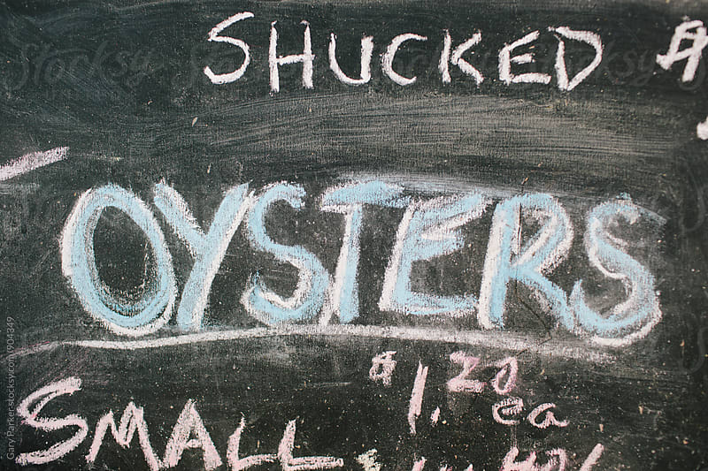 Shucked Oysters chalk sign by Gary Parker for Stocksy United