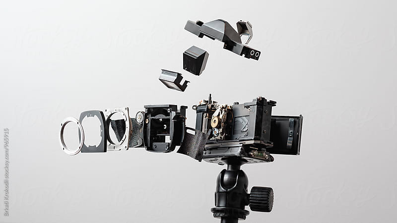 Deconstructed Analog Camera on a Tripod by Branislav Jovanović for Stocksy United
