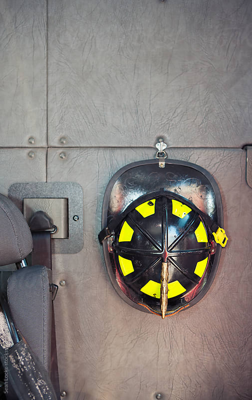Firehouse: Fireman Helmet Hanging in Truck by Sean Locke for Stocksy United