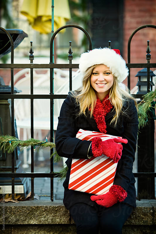 Christmas: Cheerful Holiday Shopper Takes a Break by Sean Locke for Stocksy United