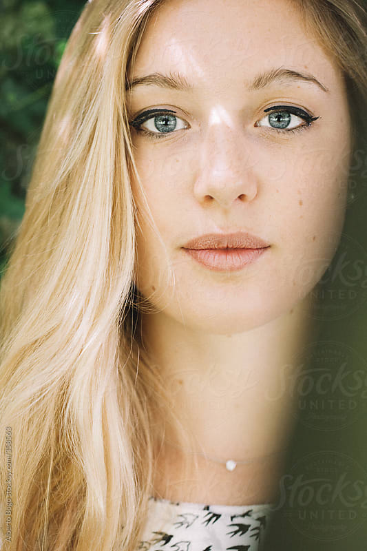 Attractive young blonde woman portrait by Alberto Bogo for Stocksy United