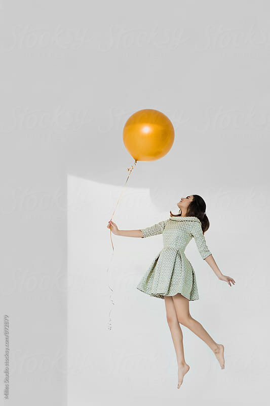 Girl with balloon by Milles Studio for Stocksy United