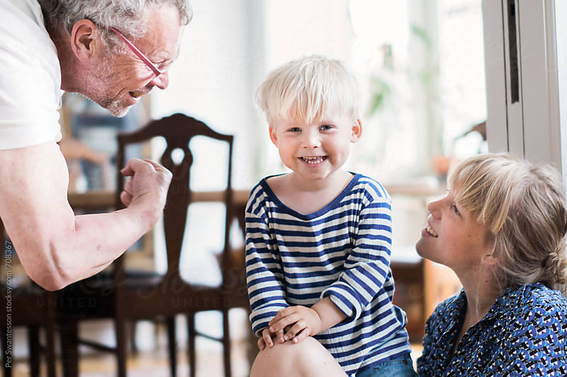 Family of grandfather, adult daughter and grandson having fun together by Per Swantesson for Stocksy United