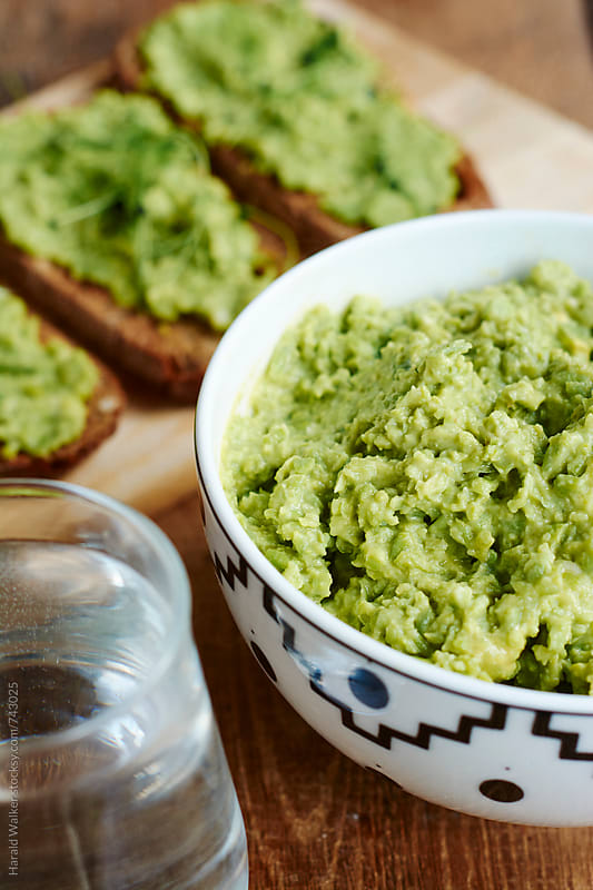 Bruschetta with Avocado Pea Spread by Harald Walker for Stocksy United