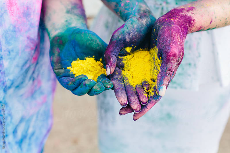 hands holding paint powder for Holi by Brian Powell for Stocksy United