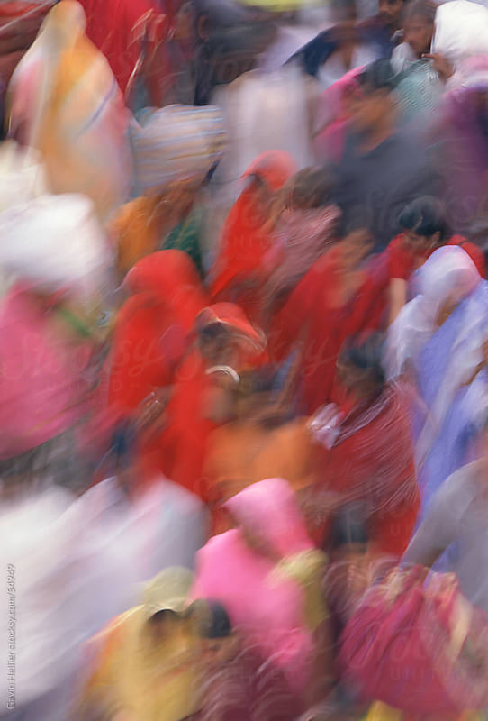 Blurred motion, crowd of people in colourful Saris, New Delhi, Delhi, India by Gavin Hellier for Stocksy United