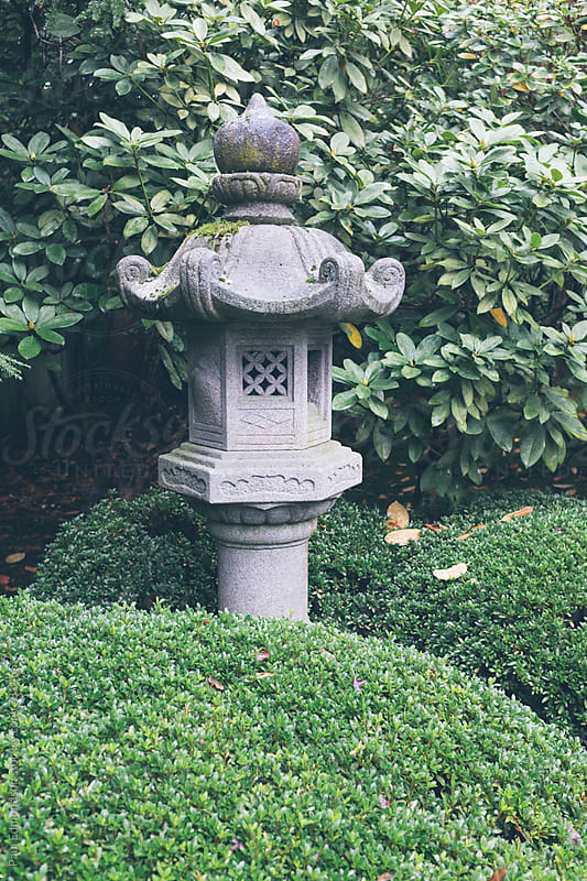 Sculpture and lush, green plantings in Japanese garden by Paul Edmondson for Stocksy United