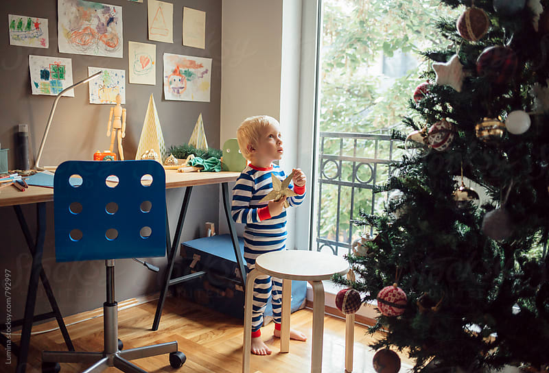 Blond Boy Decorating the Christmas Tree by Lumina for Stocksy United