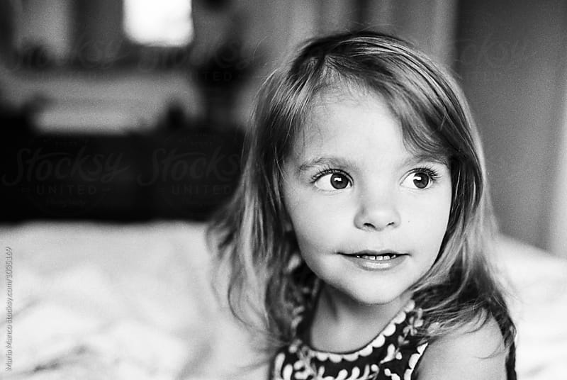 portrait of little girl by Maria Manco for Stocksy United