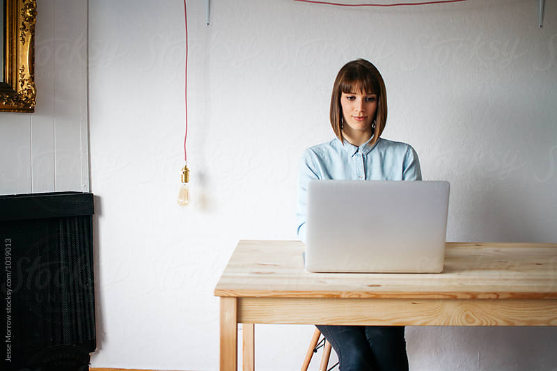 young female entrepreneur working from home by Jesse Morrow for Stocksy United