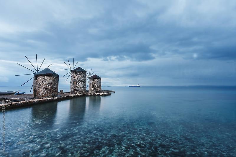 Windmills in Greece by Helen Sotiriadis for Stocksy United