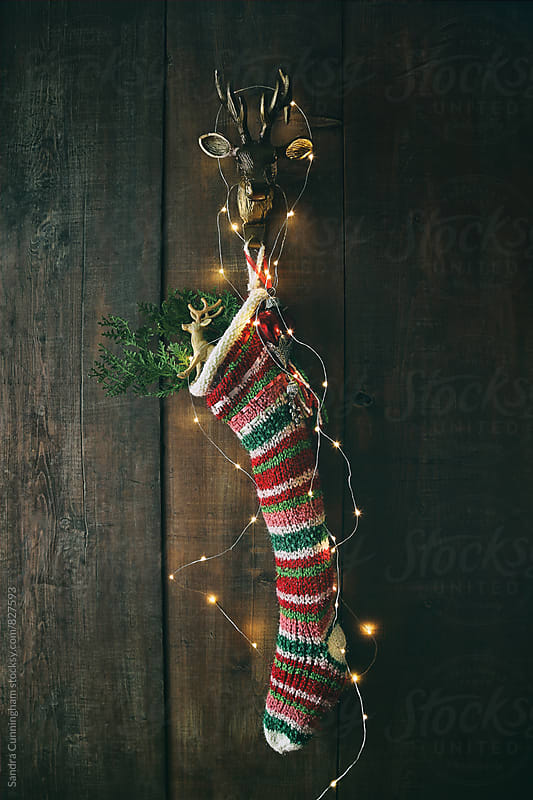 Stripe wool stocking with sparkling lights by Sandra Cunningham for Stocksy United