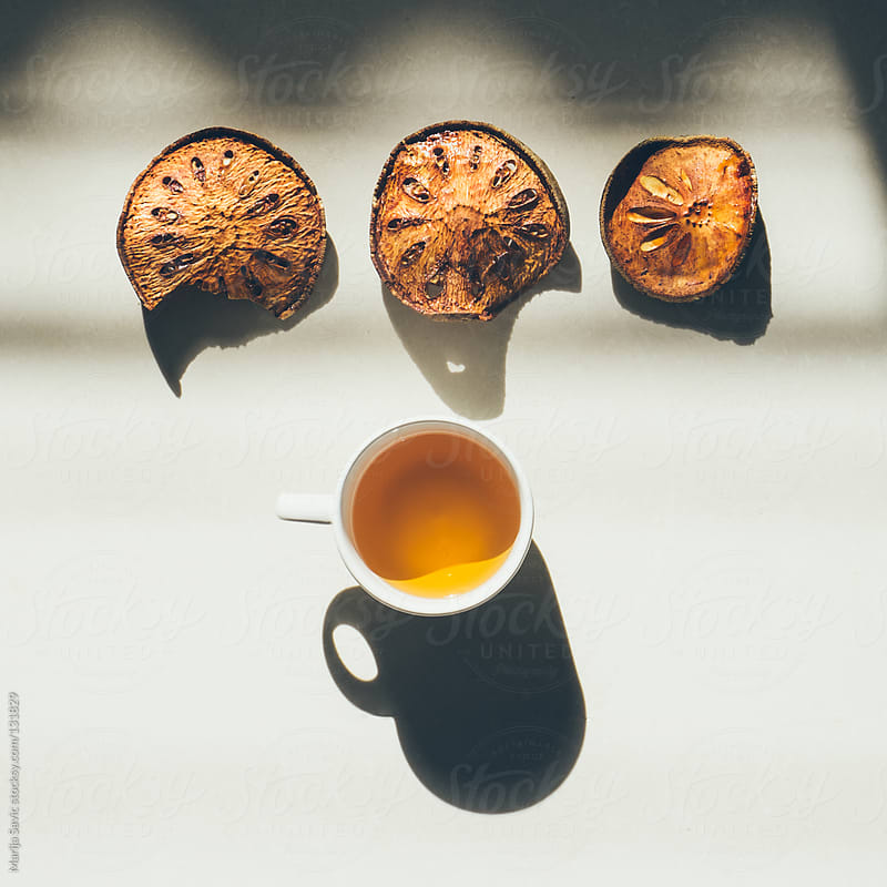 Bael fruit tea. by Marija Savic for Stocksy United