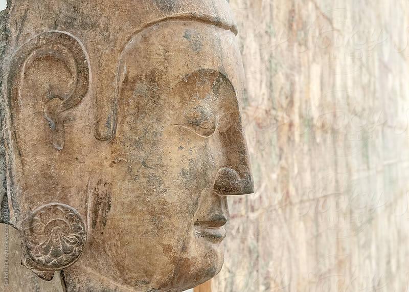 Ancient Buddha face by Gabriel Diaz for Stocksy United