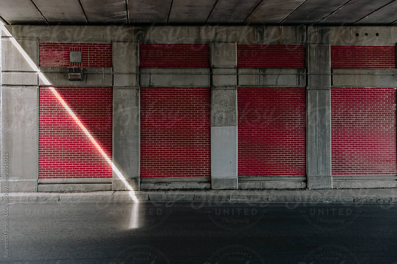 Shaft of Light in Highway Underpass  by Raymond Forbes LLC for Stocksy United