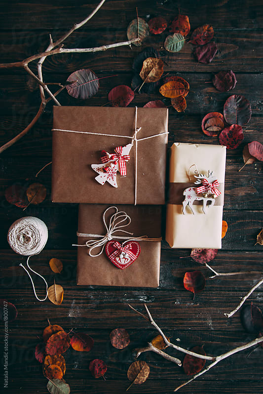 Christmas presents on a wooden table by Nataša Mandić for Stocksy United