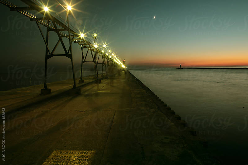 A Michigan Pier and Lighthouse at Sunset by ALICIA BOCK for Stocksy United