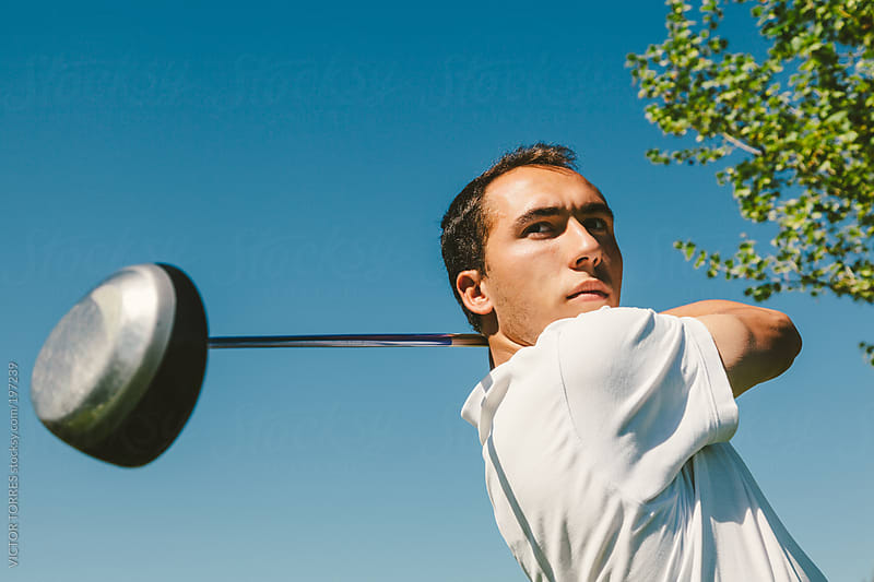 Young Man Playing Golf by VICTOR TORRES for Stocksy United