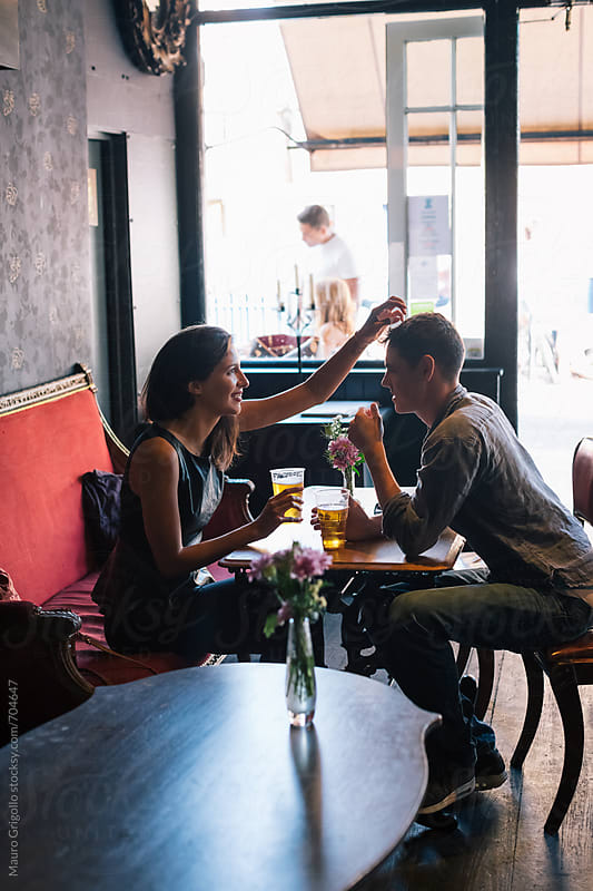 Couple in a Pub by Mauro Grigollo for Stocksy United