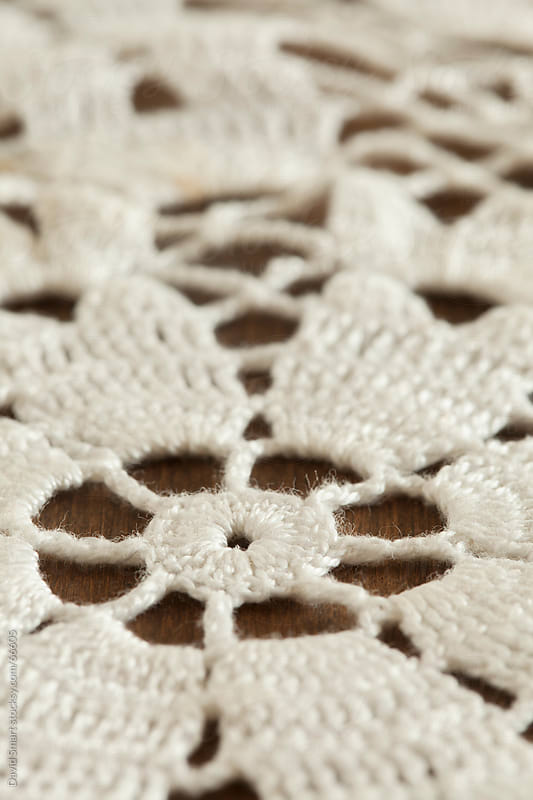 Close-up of vintage crochet doily on dark background by David Smart for Stocksy United